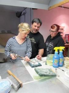 Gil, Jen, & Liza cleaning tile